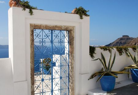 A blue wrought iron gate on the island of Santorini