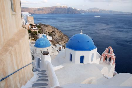 View of the caldera in Santorini with blue church domes Stock Photo