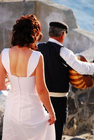 A bride being led to her wedding in Greece