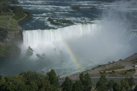 bridging: From the Canadian side, an aerial, summer view of Niagara Falls with a rainbow bridging the river. Stock Photo