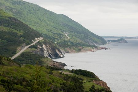 This is a Spring image of the Cabot Trail as it winds around the North end of Cape Breton Island. Within a Provincial Park, the Trail provides stunning views of rugged landscape, often next to the Ocean shores.