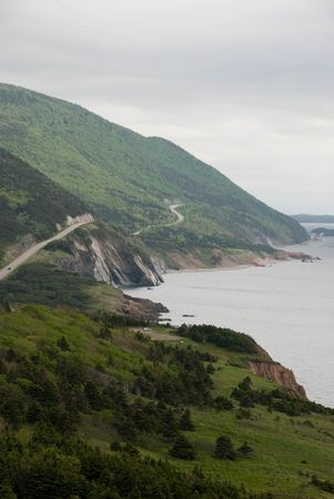 north   end: This is a Spring image of the Cabot Trail as it winds around the North end of Cape Breton Island. Within a Provincial Park, the Trail provides stunning views of rugged landscape, often next to the Ocean shores.