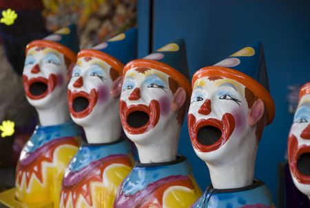 midway: Stock photo of a row of plastic clown heads in a midway booth