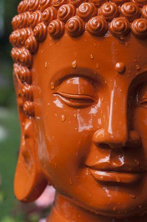 buddha face: Stock photo of an orange Buddha head