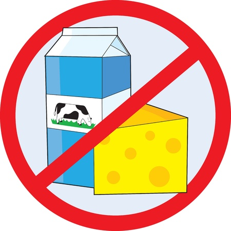A red circle outline with a slash through it, is superimposed over a piece of cheese and a milk carton with a picture of a cow on the side, clearly indicating NO DAIRY  Stock Photo