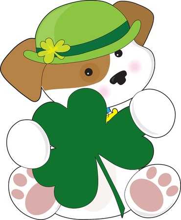 A cute puppy is wearing a green Irish hat and is holding a large green shamrock  photo