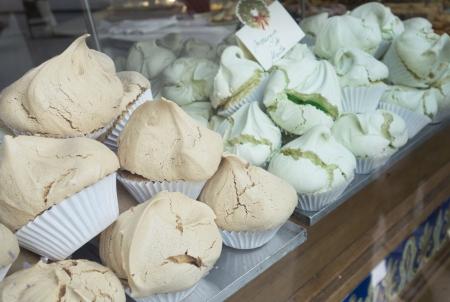 Beautiful fluffly meringues in a bakery window in Barcelona