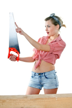 young woman with a saw on a white background photo