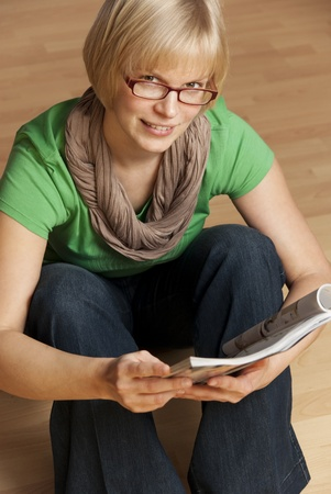 young student with glasses in blue jeans and green shirt Stock Photo - 11029543