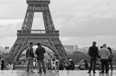 people talking with eiffel tower as background