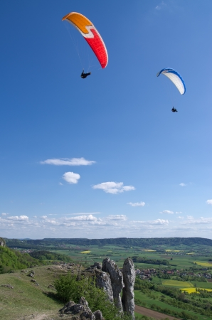 two paraglider fly high above the ground Stock Photo - 13686263