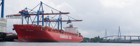 nautic: cargo vessel in the harbour at Hamburg, Germany Editorial