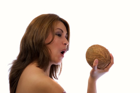 Women fights with a coconut photo