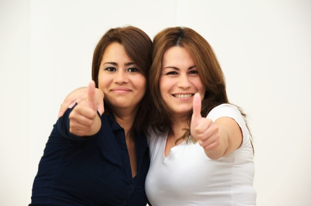 Two women s thumbs up
