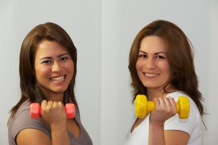 Two women s exercising gym photo