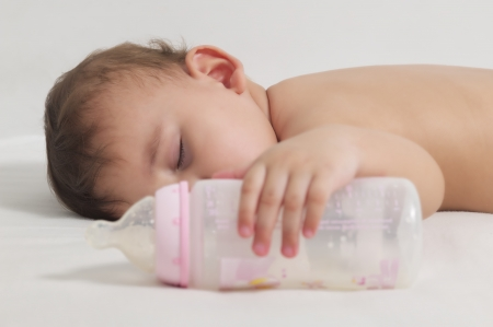 Baby sleeping after drinking here bottle milk photo