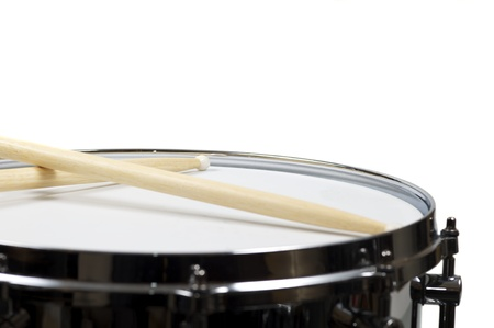 Snare drum with a pair sticks, isolated over white photo