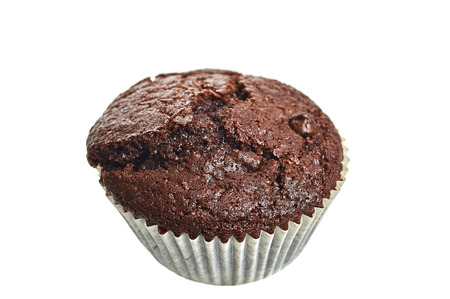 Chocolate Muffin With Chips Isolated Over White Background