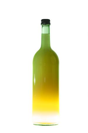 Green Bottle With Light From The Bottom Standard-Bild