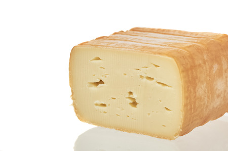 Closeup Of Cheese Over White