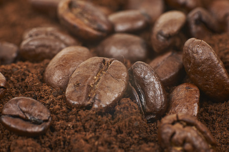Closeup Of Coffee Beans With Grained Coffee