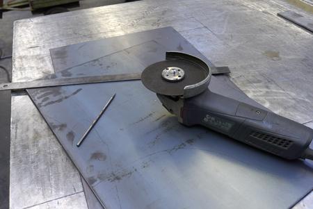 Anglo Grinder On Steel Plate