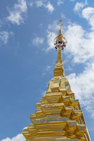 pinnacle: Golden pinnacle in thailand temple with colorful blue sky in the afternoon sunlight and shadow at sunny weather day Stock Photo