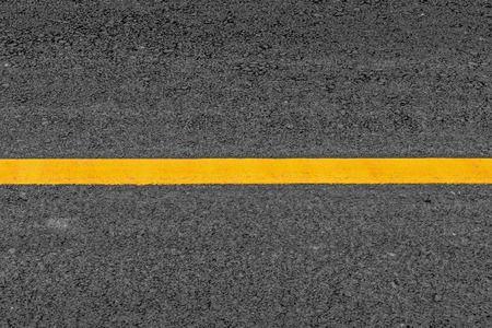 grainy: Yellow line on asphalt texture road background with grainy