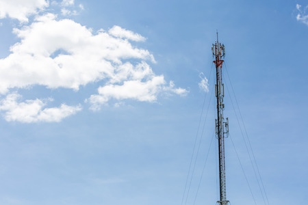 The communication tower with sky clear in north of thailand Stock Photo