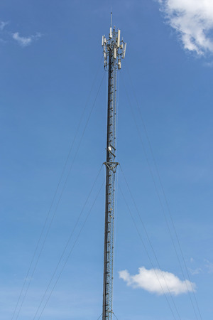 Thai mobile communication tower and sunny day in chiang mai, thailand Stock Photo