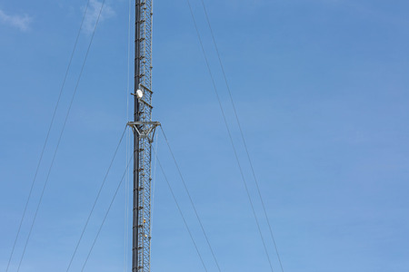 Center of telecommunication tower in sky clouds Stock Photo
