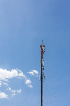 The telecommunication tower in sky with clouds background in the afternoon sunlight