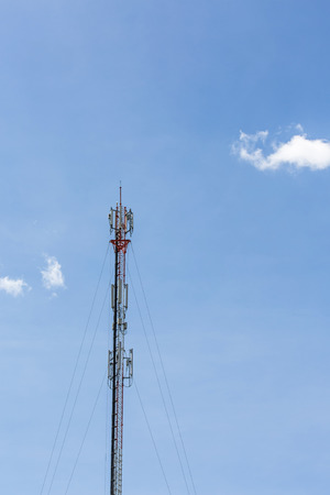 The mobile communication tower and sunny day in north of thailand Stock Photo
