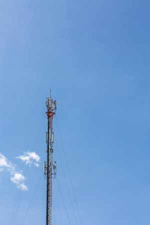 The mobile communication tower and sky with clouds in the afternoon sunlight