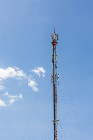 The telecommunication tower in cloud in the sky in the afternoon sunlight Stock Photo