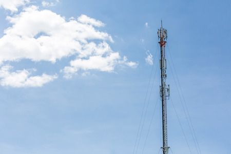 The telecommunication tower in sky with clouds background in north of thailand