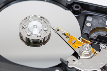 harddisk: Harddisk drive with top cover open on white background macro shot soft focus