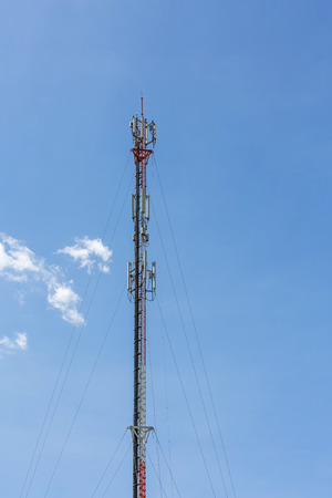The communication tower with clouds sky in the afternoon sunlight Stock Photo