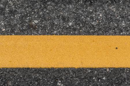 road texture: Tessitura Strada asfaltata con la linea gialla Archivio Fotografico
