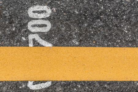 road texture: Asphalt road texture with yellow line with number Stock Photo