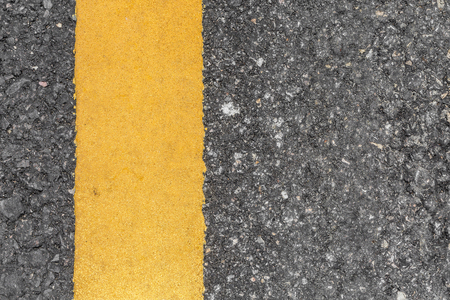 asphalt road: Asphalt road texture with yellow line Stock Photo