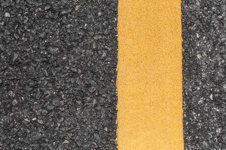 road texture: Asphalt road texture with yellow line Archivio Fotografico