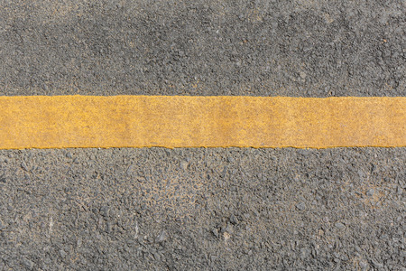 road surface: Yellow line dirty on black asphalt road texture