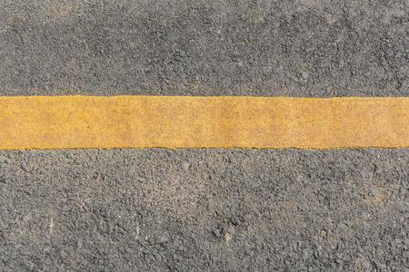 Yellow line dirty on black asphalt road texture