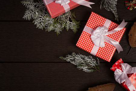 christamas: Christmas gift box vintage on dark wooden background, rustic for use for display or put your product and dry leaf.