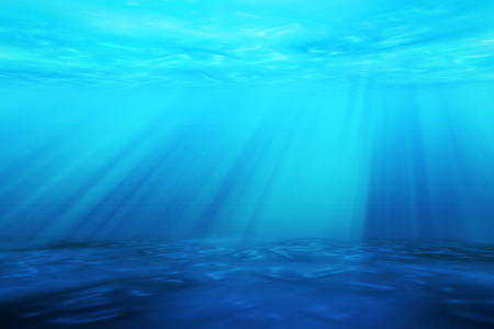 beneath the surface: Ray light of underwater scene for seascape background.