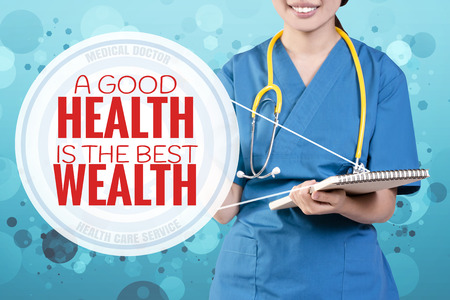 longevity: Smile female doctor with blurry blue glitter point to text: A Good Health is the Best Wealth