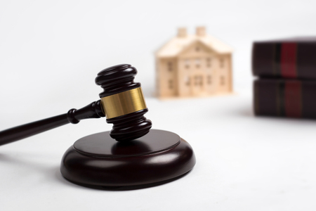 bidding: Gavel wooden, house, lawyer book for home buying or selling of bidding or lawyer of home real estate and building concept. Stock Photo