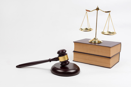 defendant: Wooden gavel, lawyer books and golden scales, equipment of lawyer legislation concept
