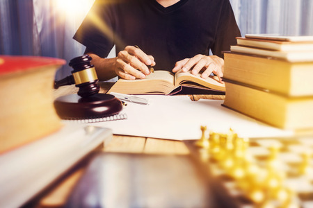 Close up business man lawyer working busy at his desk, lawyer business job concept. Stock Photo
